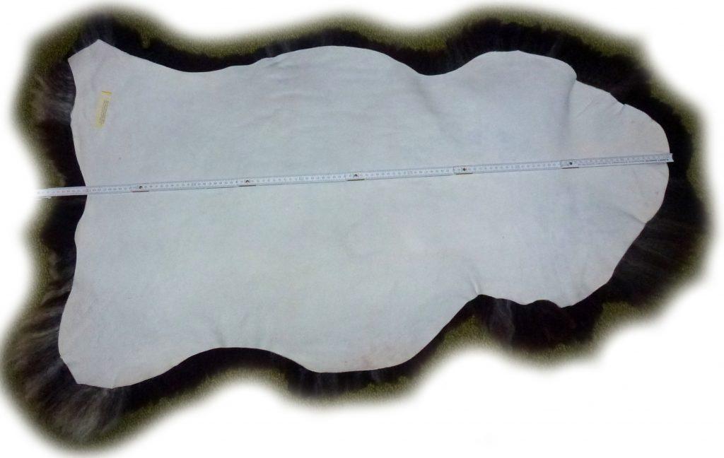 Schaffell braun weiß gescheckt