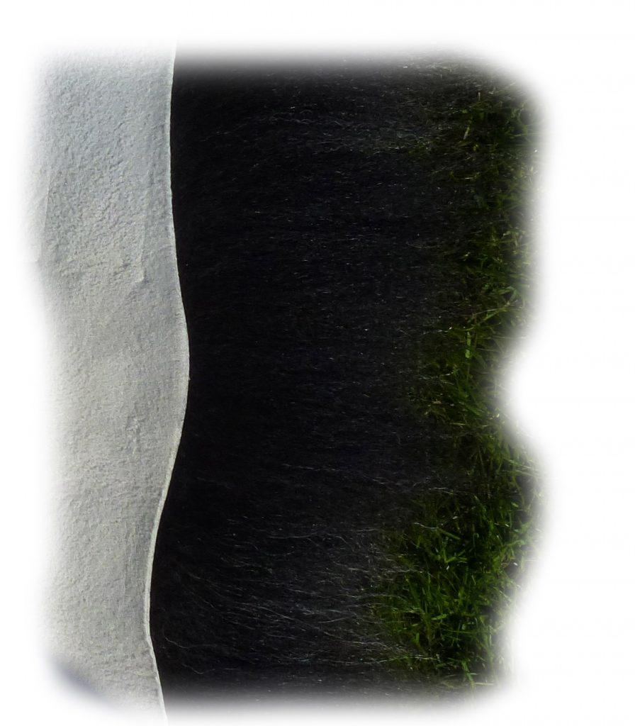 Heidschnuckenfell grau melliert Detail
